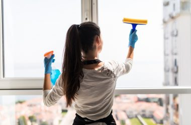 A girl cleaning windows